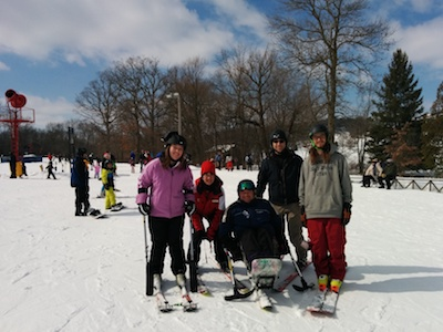 students and instructors gather for photo after mono-ski and 4-track lessons